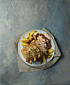 Rack of pork with gravy and baked potatoes