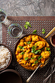 Vegan cauliflower and sweet potato curry with cashew nuts, chilli and coriander