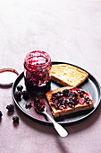 Homemade blackberry jelly on a sourdough bread