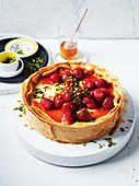 Cheese cake with filo pastry, strawberries and pistachios