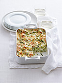 Lasagne with cheese cream, green asparagus and almonds