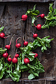 Radishes on rustic board