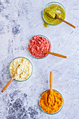 Lime, grapefruit, strawberry and pineapple fruit powder in bowls