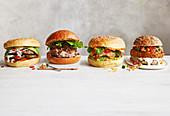 Vier verschiedene Burger