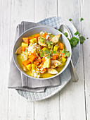Chicken stew with rice, carrots, potatoes and coriander greens