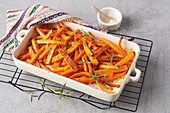 Fried carrot sticks with rosemary
