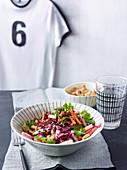 Kohlrabi salad with carrots and cashew nuts