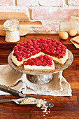 Gluten-free raspberry cheesecake with a crispy base