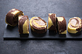 Vegan vanilla-chocolate-Swiss roll with nougat-cream filling
