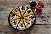 Vegan mango cheesecake with chocolate oatmeal base and berries