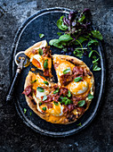 Eggs Benedict pizza with bacon