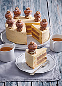 Cake (gateau) with caramel cream and small douhnuts