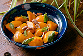 Roasted Peaches with almonds and mint prepare