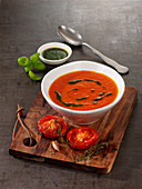 Vegan stewed tomato soup with basil and garlic oil