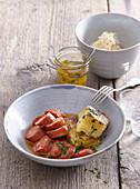 Marinated sausages with potato gratin