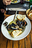 Mussels in the stock served with toasted bread