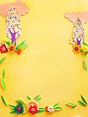 Blumendekoration auf gelbem Hintergrund