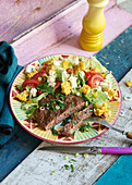 Tex-Mex mince steaks with corn salad