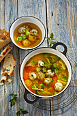 Vegetable soup with herb dumplings