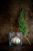 Garlic pod in a glass with rosemary