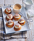 Sweet buns with marchpane and butter cream