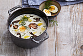 Sour mushroom soup with boiled egg