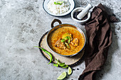 Fish and coconut curry with tamarind and raw mango