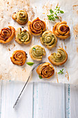 Vegan puff pastry spirals filled with red and green pesto