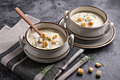 Vegan parsnip cream soup with croutons and dill