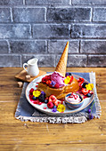 Berry brioche French toast with ice cream and edible flowers