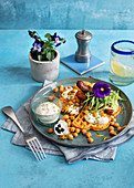 Tortilla waffles with chorizo, chickpeas and edible flowers