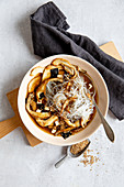 Mushroom soup with glass noodles and sesame seeds