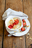 Millet porridge with strawberries and flaked almonds