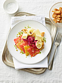 Citrus fruit carpaccio with caciocavallo cheese, pistachio nuts and red onions