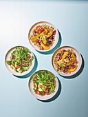 Bulgur Lunch Bowl mit Avocado und Oliven und mit Rote Bete und Orangen