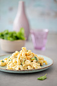 Vegan macaroni and cheese with garlic crumbs