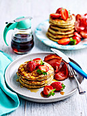 Basic pancakes with strawberries and maple syrup