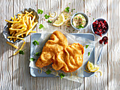 Wiener schnitzel with french fries and dips