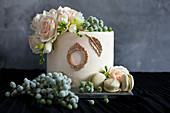 Festive white wedding cake decorated with flowers