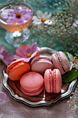 Different colored macarons on a silver plate
