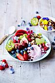 Crunch bowl with fresh fruits, berries and vegan yoghurt