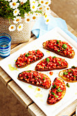 Bruschetta with tomato, basil and capers