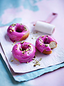Watermelon-glazed doughnuts with minted pistachio crush