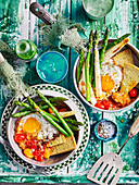 Chickpea pancake with fried eggs and tomatoes
