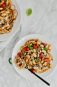 Spaghetti with white beans, tomatoes and goat's cheese
