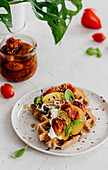 Savoury waffles with peaches and tomatoes