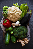 Box of fresh vegetables - cauliflower, broccoli, celery, zucchini, eggplant, mushrooms and red pepper