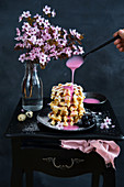 Waffles with pink raspberry glaze