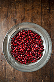Pomegranate seeds in a metal plate