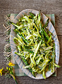 Raw and cooked asparagus with lemon and parmesan butter